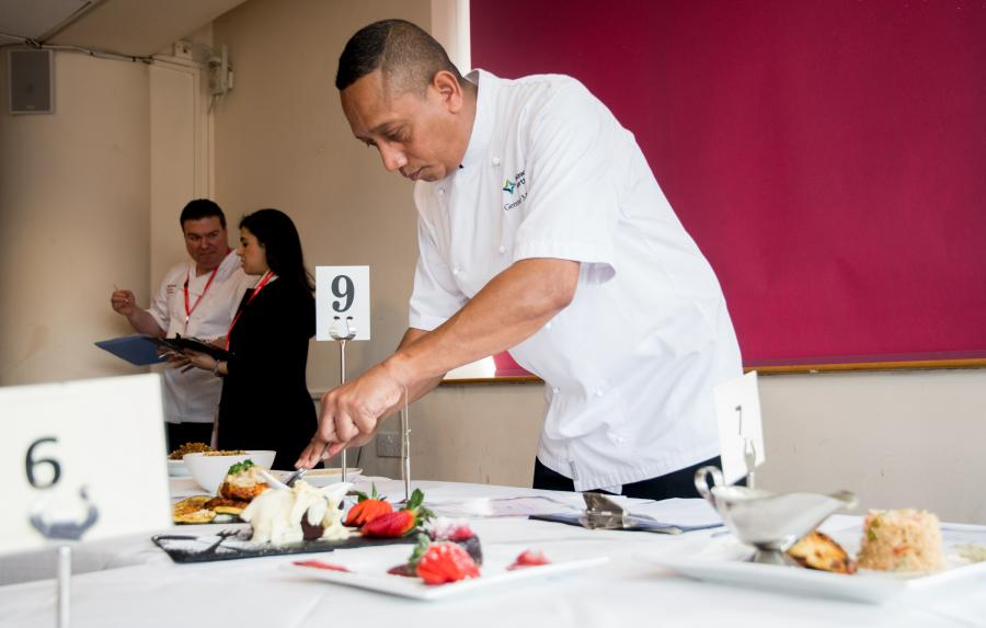 Wembley Stadium head chef, Gerrard Madden, judging the courses prepared by the young chefs