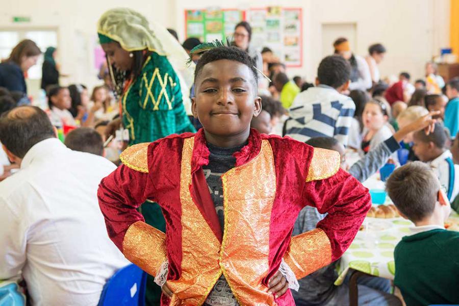 Nathaniel Frimpong-Santeng, nine, shows off his flamboyant costume