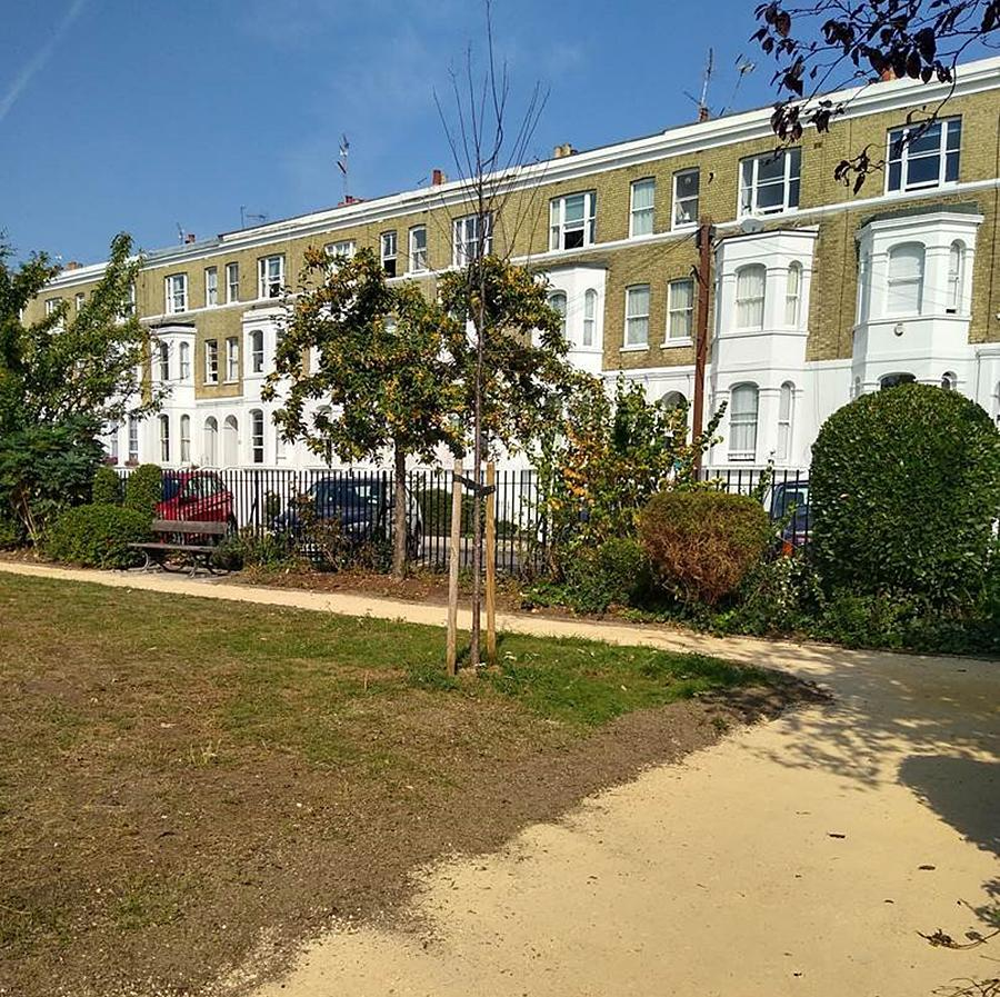 The newly installed permeable gravel path with Westcroft Square residential properties in the background