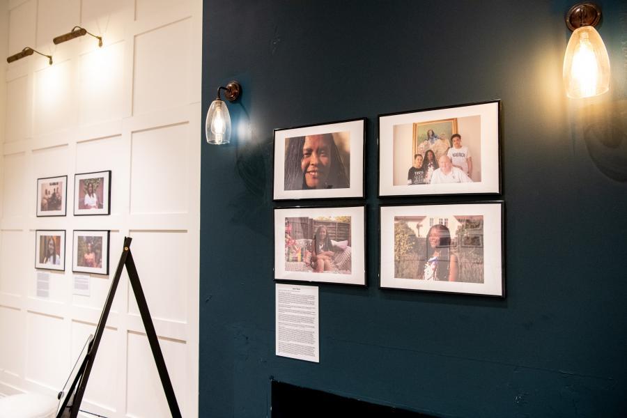 Photographs displayed on the temporary gallery wall