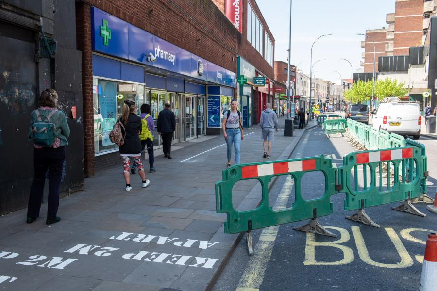Green barriers taking over some of King Street to create wider pavements
