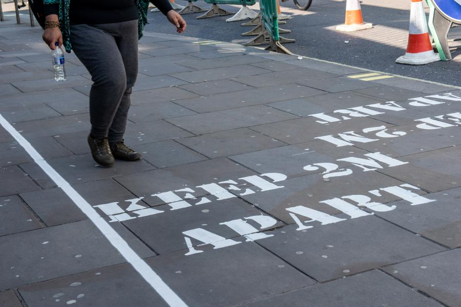 'Keep 2m apart' message stencilled in white painted onto the pavement of King Street in Hammersmith