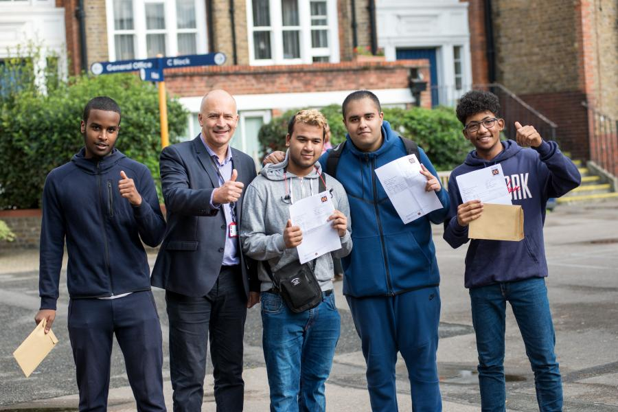 William Morris Sixth Form principal Matthew Coulbeck with successful A-level students