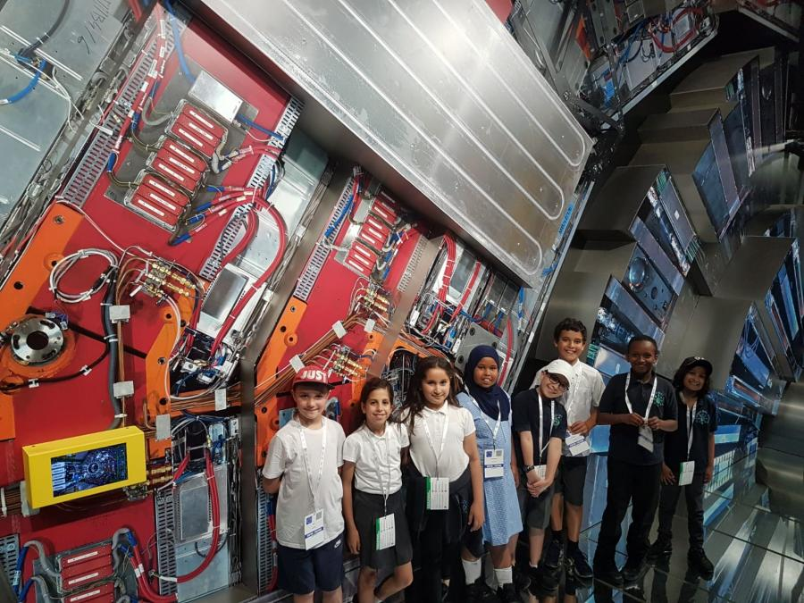 Wormholt Park Primary School pupils next to the CERN Large Hadron Collider