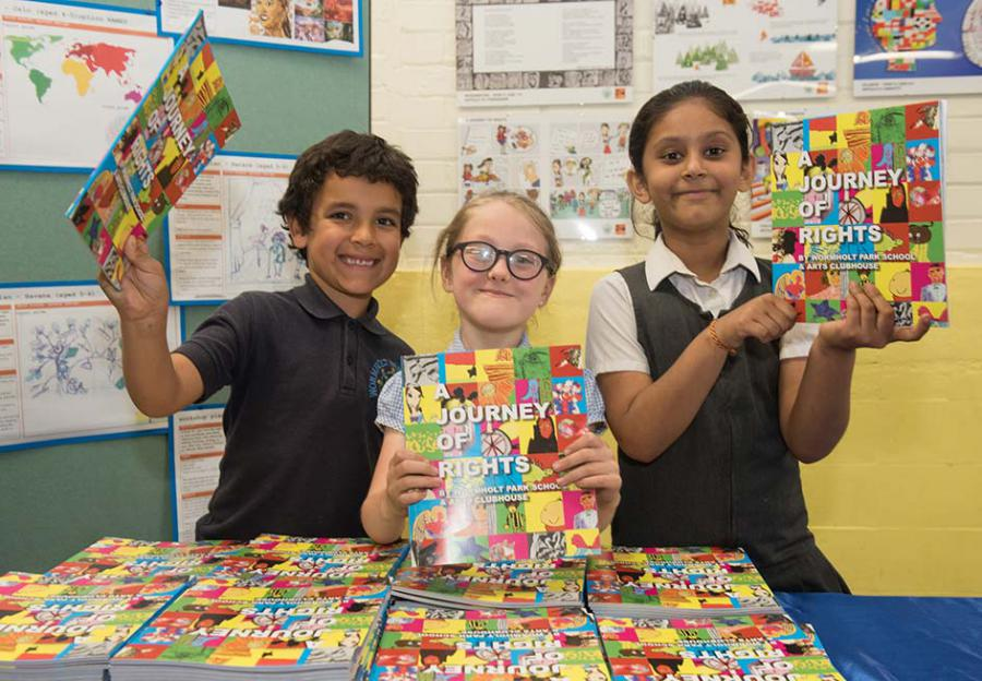 Barnaby, Willow and Diya show off the books