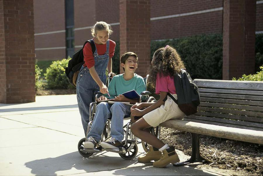 Young people with a wheelchair user
