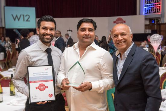 Dels pick up their Best Shepherds Bush Business award in 2018