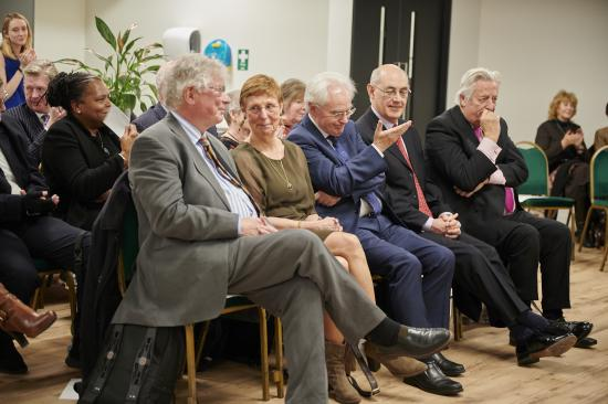 The campaigners and commissioners seated at the meeting ready to receive their awards