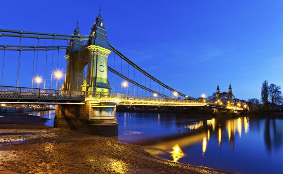Hammersmith Bridge at dusk with electric lighting switched on