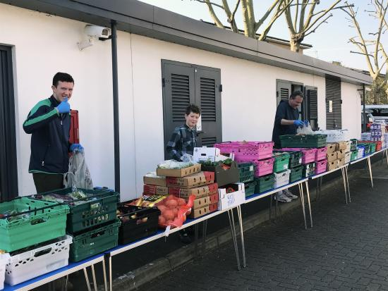 Hammersmith Academy students packing fresh food supplied on outdoor tables