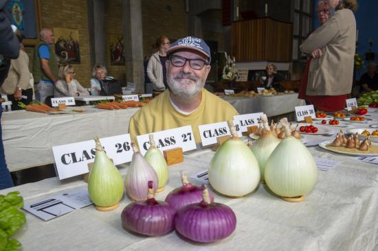 John Rielly with his collection of onions