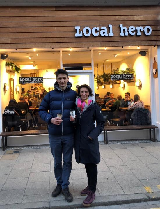 Petar Blazevic and wife Mirjana standing outside Local Hero with cups of coffee