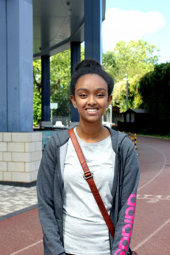 Milcah Tareke stood outside Hammersmith Academy in the sunshine