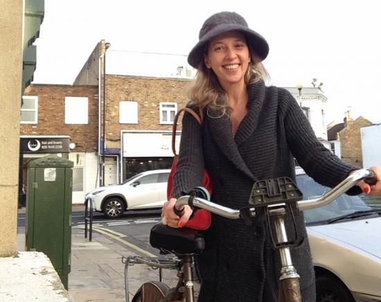 Connie Carrasco with her bike that she purchased from one of her Nextdoor neighbours