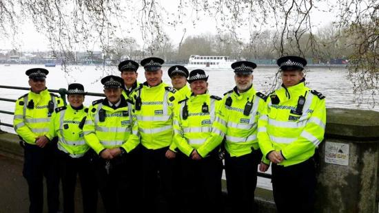 Group of H&F parks police officers stood on the pavement by the river Thames