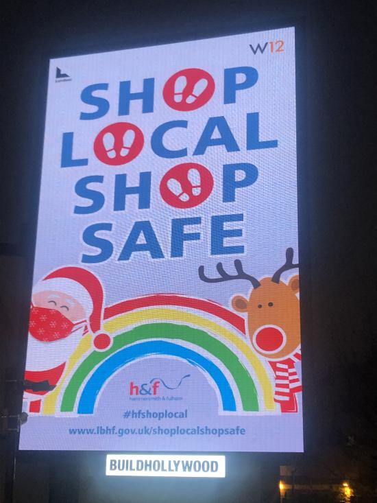 Digital advertising board showing the Shop Local, Shop Safe Christmas campaign message