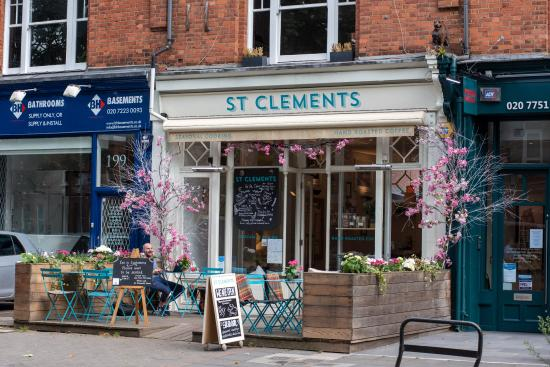 Customers sitting on the street outside St Clements cafe at tables and chairs