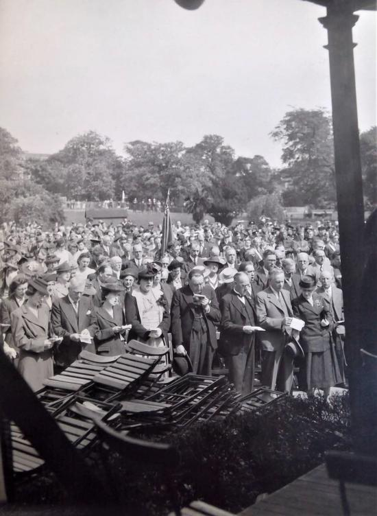 Group of H&F residents giving thanks at the bandstand in Ravenscourt Park, Hammersmith on 13 May 1945