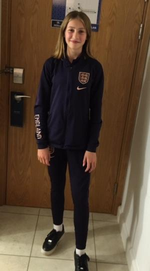 Ava Huntrods wearing the England football national team training kit