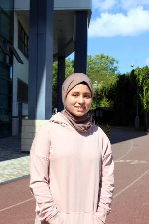 Batoul Gheleb stood in the sunshine outside a school building