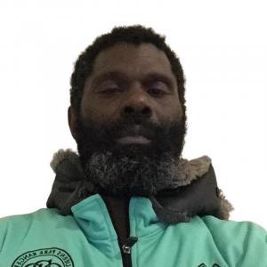 George wearing a QPR jacket