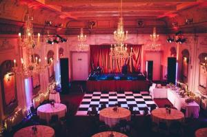 Auditorium at Bush Hall showing the stage and tables laid out for an event