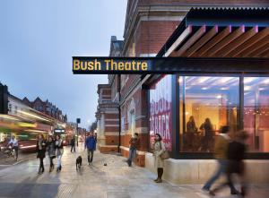 The Bush Theatre in Shepherds Bush with pedestrians walking by the building on the pavement