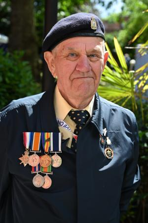 D-Day veteran with medals at the commemorative event