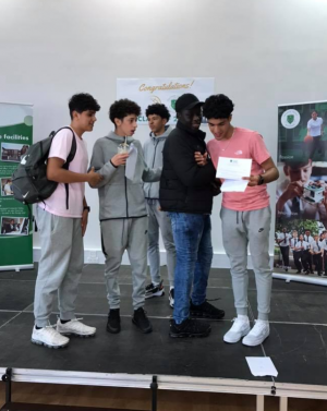 Group of male students picking up their GCSE results at Fulham Cross Academy