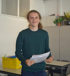Jamie Levinson reading his GCSE results from a piece of paper