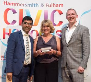 Julie Cavanagh being presented with her award by Cllr Asif Siddique and Matt Campion