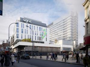 The Lyric Hammersmith sitting behind Lyric Square with pedestrians walking around
