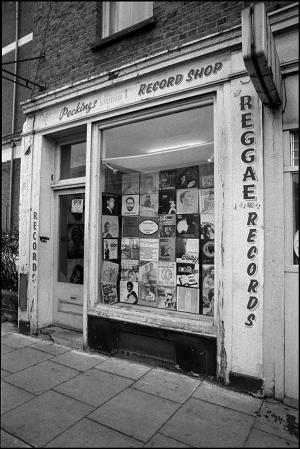 Black and white photo of the Peckings Record storefront