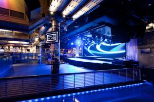 bar and performance area of Under The Bridge with stage lights, bar space and branded merchandising