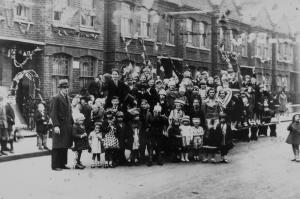 Crowd of residents and children gathered in Oakbury Road, SW6 to celebrate VE Day in 1945